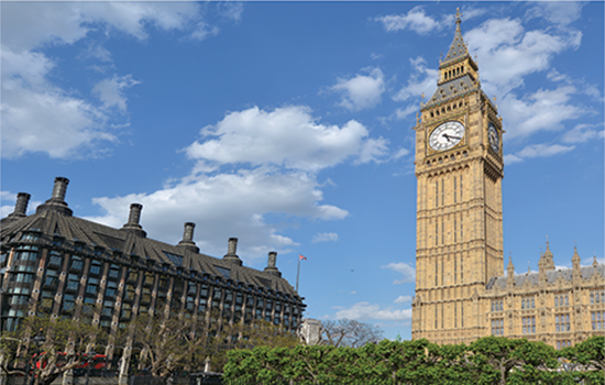 The Big Ben clock tower on Elizabeth Tower of Palace of Westminster and Portcullis House in London, UK.